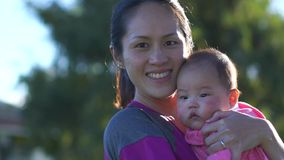 Slow motion of Asian Mother and baby outdoors stock video footage