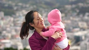 Slow motion of Asian Mother and baby outdoors stock footage