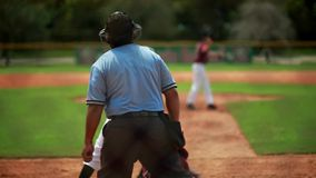 Slow motion of a baseball player batting during a game.