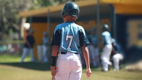 Slow motion of batter getting ready to bat during baseball game. stock footage