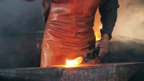 Slow motion of the blacksmith forging iron. HD stock video