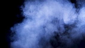 Slow motion blue smoke rising from bellow