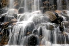 Slow motion blur waterfall. Slow motion blur background of rocky waterfall royalty free stock photos
