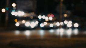 Slow motion of blurred mobving cars in urban night. Cinema-like color stock video