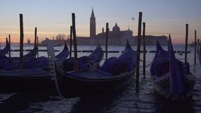 Slow motion of gondolas and boat traffic in Venice with San Giorgio Maggiore stock footage