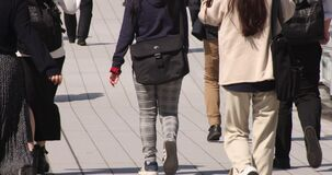 A slow motion of body parts of walking people at urban city in Shibuya
