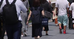 A slow motion of body parts of walking people at urban city in Tokyo