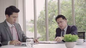 Slow motion - Businessman meeting in workplace with his colleague and signing a contract.