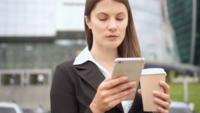 Slow Motion Businesswoman using smart phone in city downtown, professional female employer browsing. Slow Motion Young successful businesswoman in suit using stock footage