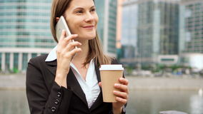 Slow Motion Businesswoman using smart phone in city, professional female employer talking on phone. Slow Motion Young successful businesswoman using smart phone stock video