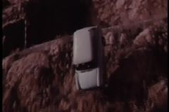 Slow motion car falling off cliff into water stock footage