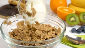 Slow motion of cereals flakes falling in bowl for breakfast stock video