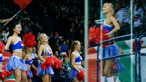 Slow motion cheerleaders dance near stands at intermission. Kazan, Tatarstan Russia - June 29 2018: Slow motion pretty girls cheerleaders dance in front of stock video footage