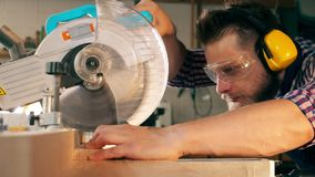 Slow motion of a circular saw being used to process wood. HD stock footage