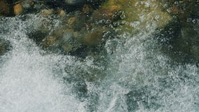 Slow motion of clean flowing water on the stones stock footage