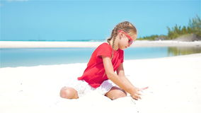 SLOW MOTION CLOSE UP: Girl playing with beautiful white sand at tropical beach stock video footage