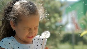 Slow Motion Close-Up Shot of Cute Little Girl Carefree Blowing a Dandelion Outdoors on a Sunset. Concept of Happy stock footage