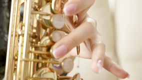 SLOW MOTION close up of woman playing on saxophone stock video