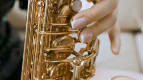 SLOW MOTION close up of woman playing on saxophone stock video footage