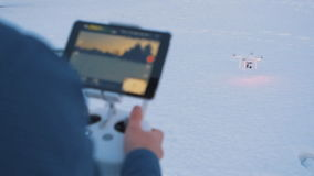 SLOW MOTION CLOSEUP: Drone operator holding a transmitter stock video