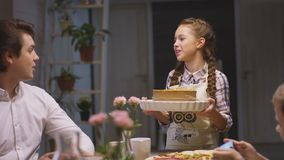 Girl Brings Pie to Please Family Brother Photos. Slow motion closeup pretty girl brings baked pie to please family and brother takes sister photo stock video footage
