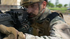 Slow motion closeup of a soldier and his military gun during a special training exercise stock video footage