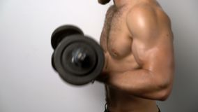 Shirtless muscular man training with Resistance Band stock footage