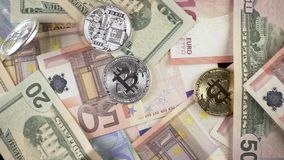 Slow motion coins fall for cash euros and dollars top view