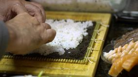Slow Motion of cooked white rice for making sushi and rolls. Japanese food stock footage