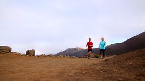 Slow Motion - Couple Trail Running Outside. Slow motion shot of couple running on dirt trail outside stock footage