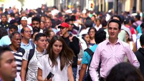 SLOW MOTION: Crowd walking through street. In Mexico the population growing is a public problem due the high birth rates. Mexico City, CIRCA June,2018 SLOW stock video