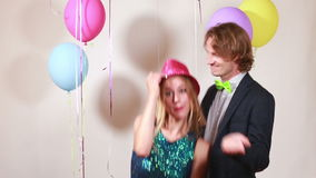 Slow motion of cute couple dancing in photo booth. Cute smiling couple dancing in photo booth, in slow motion stock video footage