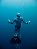Slow motion from the depth. Freediver slowly rises up from the depth of the Blue Hole in Dahab, Egypt royalty free stock images