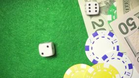 Slow motion dice roll on chips and money casino. Slow motion dice roll on chips and money free place casino stock video