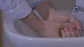 Slow motion doctor carefully wash their hands before surgery stock video