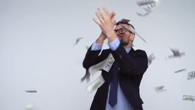 Slow motion of dollars falling on formally dressed man. Dollar bills falling on formally dressed man. Slow motion stock video