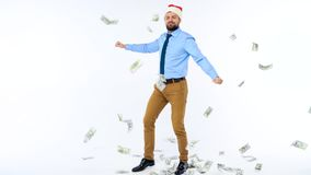 Slow motion of dollars falling on formally dressed man in the Santa Claus hat. Dollar bills falling on formally dressed man in the Santa Claus hat. Slow motion stock footage