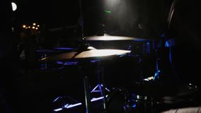 Slow motion. Drummer hand playing drum plate on rock concert. Drummer hand silhouette with drumstick. Close up of drummer hand playing drum plate on rock concert stock video