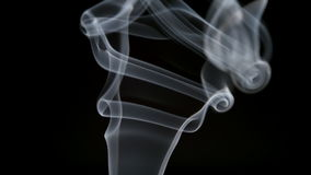SLOW MOTION: Elegant curve smoke lifts up on a dark background stock video