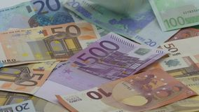 Slow motion of euros are falling. Banknotes of different values. Euro cash. Money background. Good earnings. Issuing the salary. Bank percent deposit. Credit stock footage