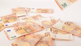 Banknotes of 50 values fly and drop on a white background. financial crash concept