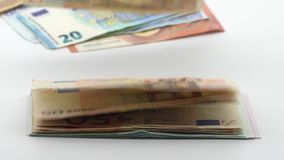 Slow motion of euros are flying and falling. Euro banknotes different values. Slow motion of euros are flying and falling. Banknotes of different values fly stock footage