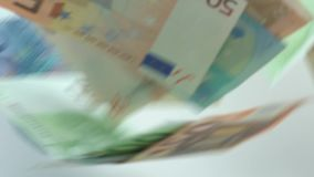 Slow motion of euros are flying and falling. Euro banknotes different values. Slow motion of euros are flying and falling. Banknotes of different values fly stock video