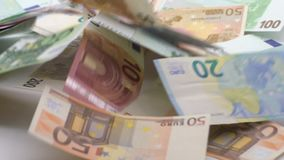 Slow motion of euros are flying and falling. Euro banknotes different values. Slow motion of euros are flying and falling. Banknotes of different values fly stock video footage