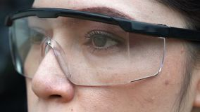 Slow-motion of eye with glasses stock footage