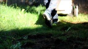 Slow motion feet mowing lawn