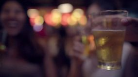 Slow motion - Female drinking alcohol or beer with friends and having party at The Khao San Road. stock video
