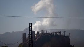 Slow motion footage of an atmospheric pollution, the factory toxic combustion is going into air