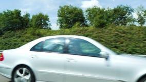 Slow motion footage defocused view of luxury Mercedes-Benz C-Klass
