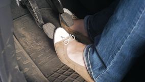 Slow motion video of female drivers legs in ballet flats while driving car with manual gearbox. Slow motion footage of female drivers legs in ballet flats while stock video footage